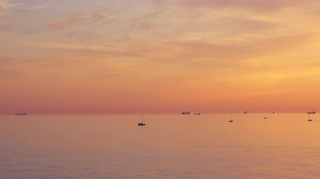 lanscape : Panoramic shoot, majestic sunset and many different ships and yachts in the sea, full hd pro res video.