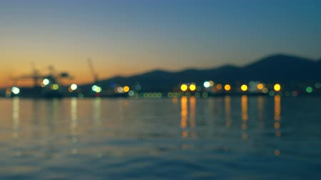 Defocused background of large port and city at sunset
