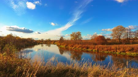 Timelapse of autumn landscapes, beautiful sky over river, 4k. Wideo