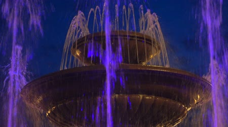 Fountain rising against evening sky. Full hd pro res video. Wideo