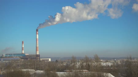 fuel and power generation : Time lapse of smoking pipes of thermal power station in winter at beautiful. Stock Footage