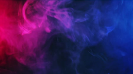 red and blue smoke patterns waving at dark background Стоковые видеозаписи