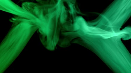 green smoke moving at dark background