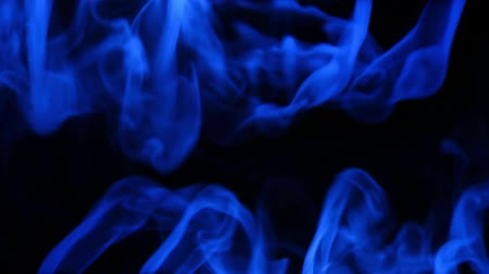 abstract blue smoke mixing on dark background