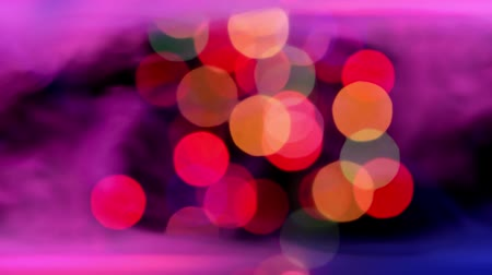 beautiful multicolor bokeh lights in smoke
