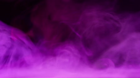 purple smoke waves over water surface