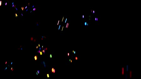 multicolor bubbles falling at black background