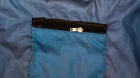 self opening zipper pocket at blue cloth background