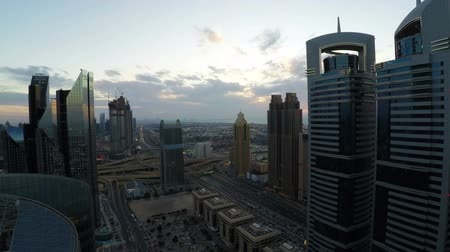 time laps : Time lapse of Dubai skyline and rush hour traffic in downtown Stock Footage