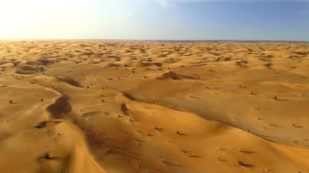 Aerial view of sand dunes in the desert in Abu Dhabi, UAE