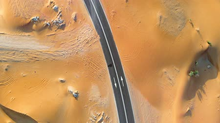 Road through Middle Eastern desert Стоковые видеозаписи