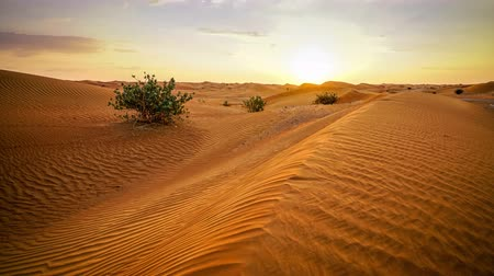 Time lapse of sunset over sand dunes in the desert in Abu Dhabi, UAE