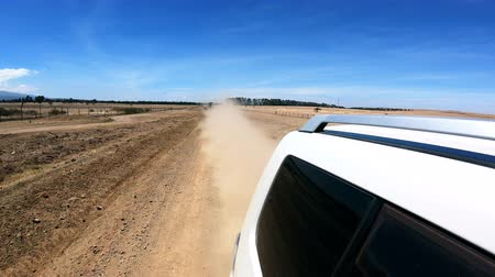 from behind : Driving on a dirt road Stock Footage