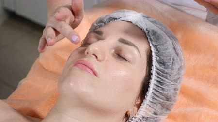 botulinum : Beauty concept. Close up of Beautician making facial massage preparing client face skin for injection. Facial rejuvenation. Shot in 4k Stock Footage