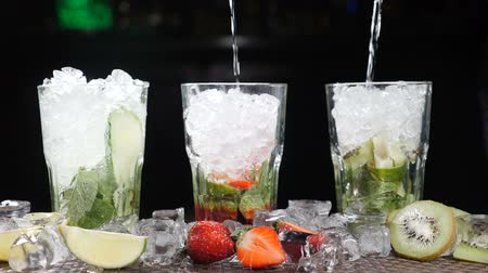 ice cube : Bar and cocktail concept. Bartender prepare different Mojito Cocktails. Close up. Splashes. Slow motion. Stock Footage
