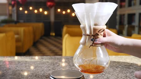 brew coffee : Modern ways of coffee making. Close up of a barista making hand brewed coffee. Stirring .Slow motion Stock Footage