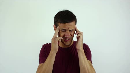 desperate : Handsome young man has a headache. Stock Footage