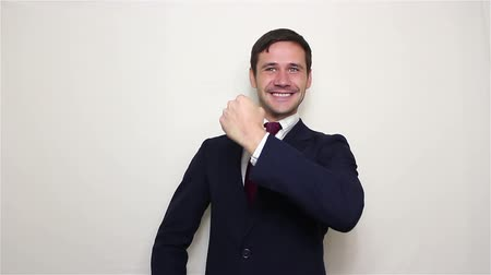 főnyeremény : Handsome young businessman actively expresses joy, makes a gesture with his hand and says yes. Stock mozgókép