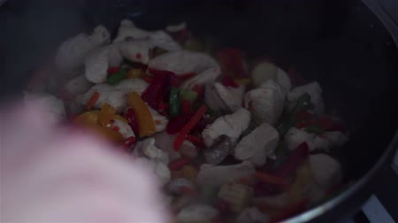 vegetable wok : Chef mixes chicken with vegetables in wok pan.