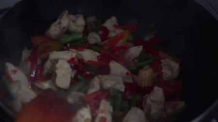 wok food : Chef mixes chicken with vegetables in wok pan.