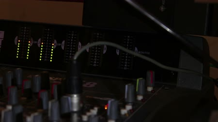 desvanecer : Sound console view with many indicators, sliders, buttons and relays. Stock Footage