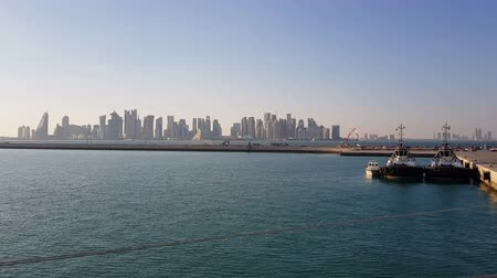 mooring : Sea port and view of the city with skyscrapers on the horizon. Sea port with moored ships. Stock Footage
