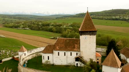 укрепленный : Aerial view of Hosman fortified church in Transylvania, Romania
