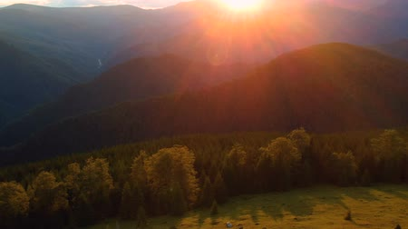 transilvânia : Aerial view of a beautiful sunset, at the forest edge Stock Footage