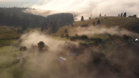 Aerial view of foggy sunrise over hills and the forest in Bucovina - Romania Стоковые видеозаписи