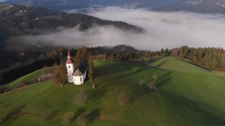 slovenya : Autumn aerial view of a beautiful church on the top of a hill, in Slovenia Stok Video