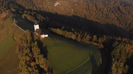 Autumn aerial view of a beautiful church on the top of a hill, in Slovenia 무비클립