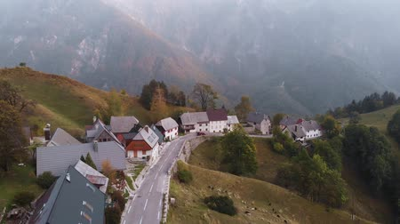 Autumn aerial view of Strmec na Predelu village, at the feet of the Julian Alps, in Triglav national park, Slovenia