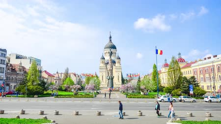 heroes square : Cluj-Napoca, Romania - 10 April: Orthodox Cathedral, Avram Iancu Statue and Square on a beautiful spring day with flowers and sun in this beautiful East European tourist attraction with lots of people