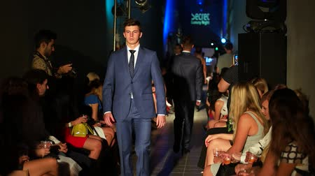 supermodel : Kherson, Ukraine 09 September 2016: Secret Luxury Night in Fabrika Mall Male model in business suits walking down the hallway in Kherson, 09 Sep. 2016. model on the catwalk defile before spectators Stock Footage