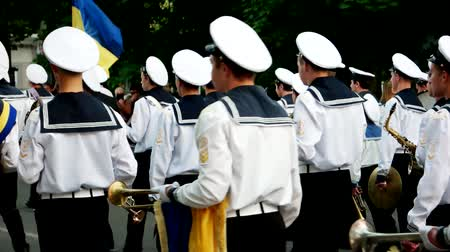 karabély : Kherson, Ukraine 20 May 2016: Festival Melpomene of Tavria Orchestra sailors walking along the main street of the city, the Naval Academy students, in Kherson, 20 May 2016.