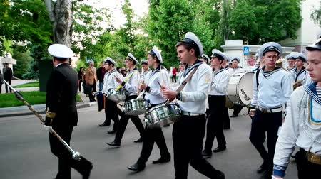 karabély : Kherson, Ukraine 20 May 2016: Festival Melpomene of Tavria Orchestra drummers sailors at a military parade, young men walking on the street drumming on a musical instrument in Kherson, 20 May 2016.