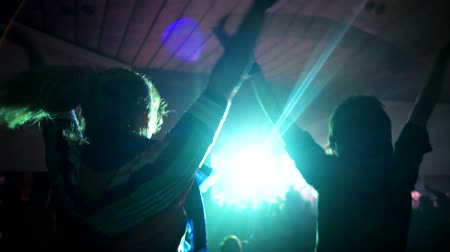 rock concert : Fans hands with mobile phones recording videos at rock concert, crowd making party at a rock concert. People raise their arms at concert. Concert Rock Band Performing On Stage With Singer Performer Stock Footage