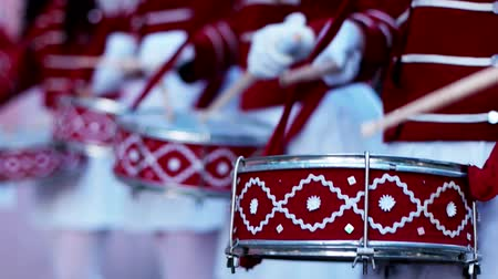 clarinet : Drummers of Orchestra of Military Music College at Music Festival. A company of girls-drummers stands in the city In a beautiful festive form, musicians pounding drumsticks on a drum Stock Footage