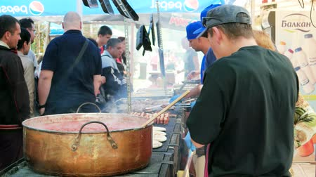 frites : Sofia, Bulgaria - 15 September 2016: chef cooks red chili sauce in vat, people on street food festival, boiling red tomato sauce in huge vat, street food, man tastes sauce in Sofia 15 September 2016.