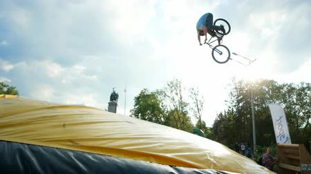 gimmick : Sofia, Bulgaria - 15 September 2016: jumping on trampoline with bike, extreme sports, making tailwhip on bmx, dangerous tricks on bike, ride bicycle, traumatic in Sofia 15 September 2016.