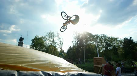 gimmick : Sofia, Bulgaria - 15 September 2016: guy makes tailwhip on bmx, jumping on trampoline with bike, extreme sports, dangerous tricks on bike, ride bicycle, traumatic sports in Sofia 15 September 2016.