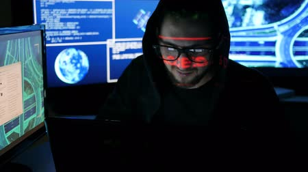 süzülme : Criminal Hacker cracking system, Computer Terrorism, Unlawfully tracking of people, objects, Internet espionage, Identity theft, hacker using laptop, computers to infiltrate, Hacker portrait, Stok Video