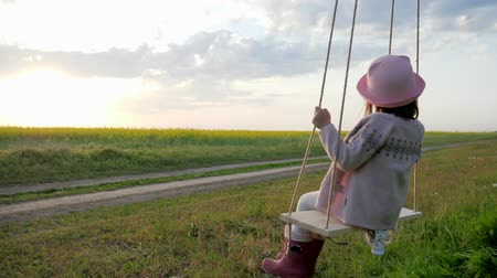 подача : children on swing, Female kid swaying, Happy little child have fun sway spin on swing, nature sunset, forest park, portrait cute girl, shakes on hanging from tree swing, slow motion