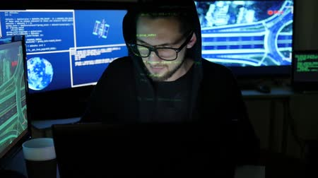 süzülme : stolen bank card hacker Holds in hands, Cyber criminal, steal finances through the Internet, male Hacker cracking Banking system, using laptop, computers, Hacker portrait, Computer Terrorism