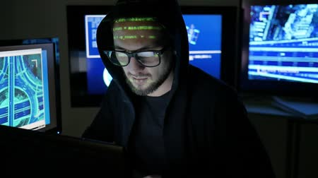 süzülme : Criminal Hacker cracking system, Computer Terrorism, Unlawfully tracking of people, objects, Internet espionage, Identity theft, hacker using laptop, computers, Hacker portrait Stok Video