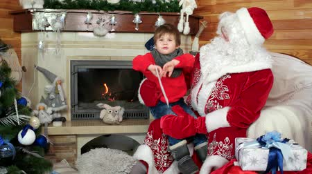 Навидад : little boy on santas lap telling his christmas wishes, kid visiting saint nicolas residence with wishlist in envelope, room with fireplace and decorated christmas tree, gifts for good and children
