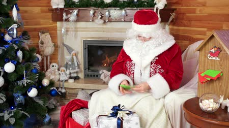 koperta : santa claus reading kids letters, saint nicolas pack gifts due to children wishlist, santa mail, room with fireplace and decorated christmas tree, holiday atmosphere, christmas presents for good kids