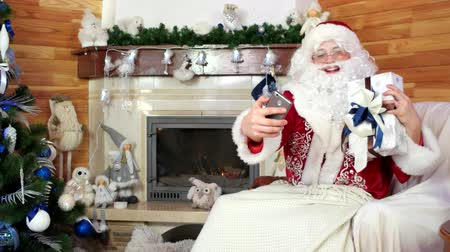 mikulás : santa taking selfie with presents, papa noel making selfie with smartphone, christmas photo, room with fireplace, decorated christmas tree, use electronic device, saint nicolas, holiday preparation