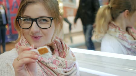 eaten : blonde flirts with camera and offers pie, Beautiful woman in glasses seductively eats cake with cream, Overweight, plastic tableware with dessert in hand, Close-up girl enjoying fresh pie, Diet broken