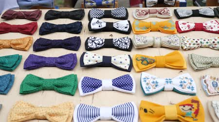 для продажи : art mens style, original textile bow-tie for male, accessories hand made on stand, clothes for hipsters, cloth bow tie for men handmade on rack, exhibition to summer ground, fashion close-up
